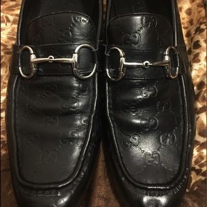 Men's Gucci monogrammed loafers